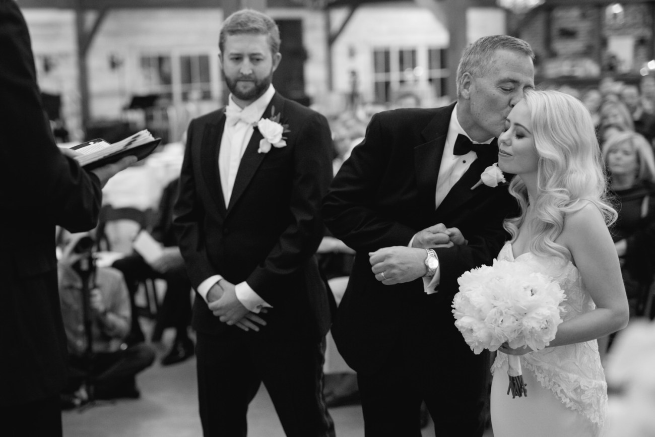 father gives away bride