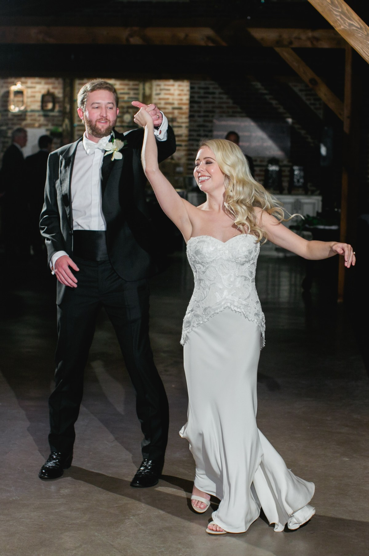 groom spins bride
