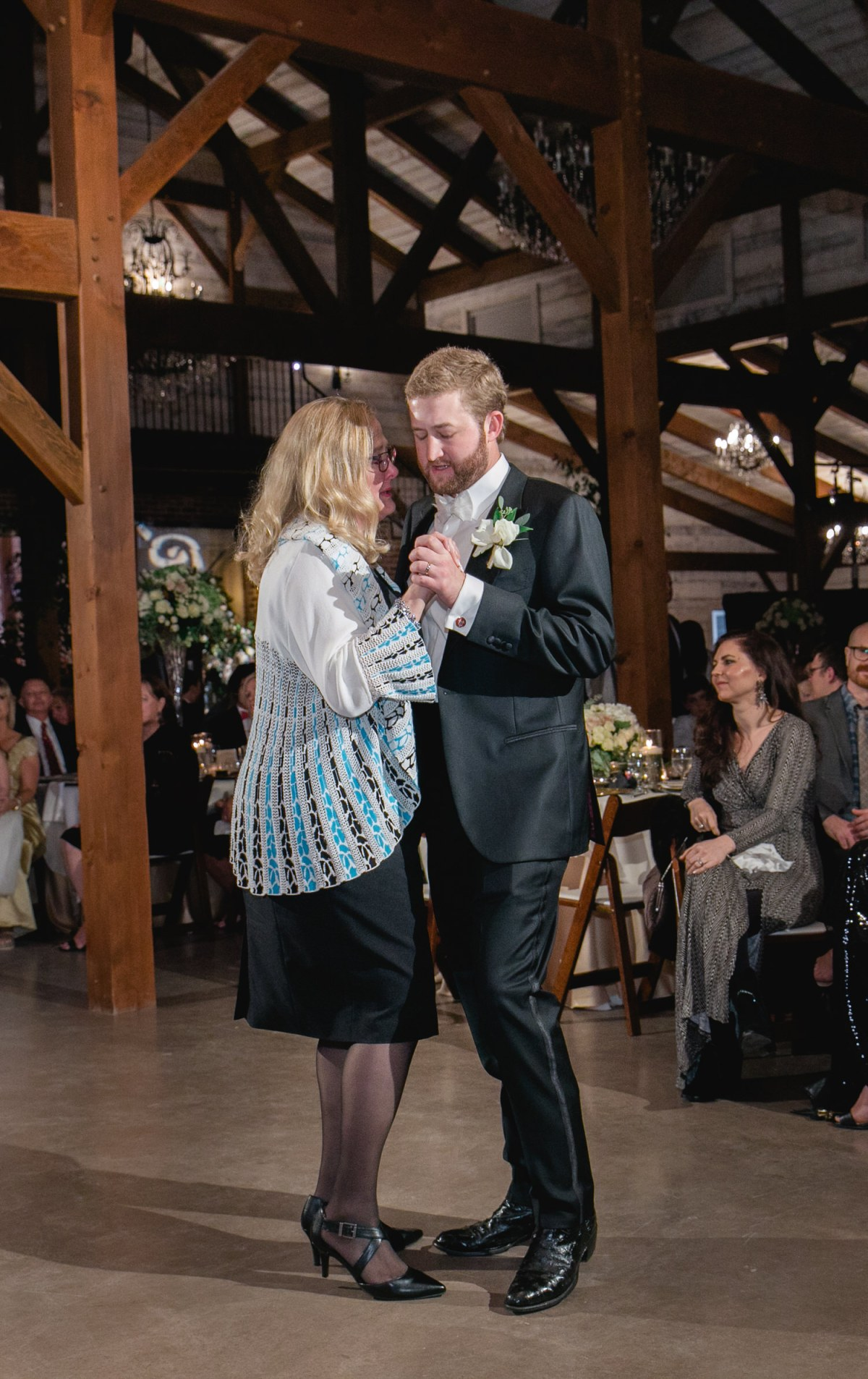 groom dancing with mom at eberley brooks events