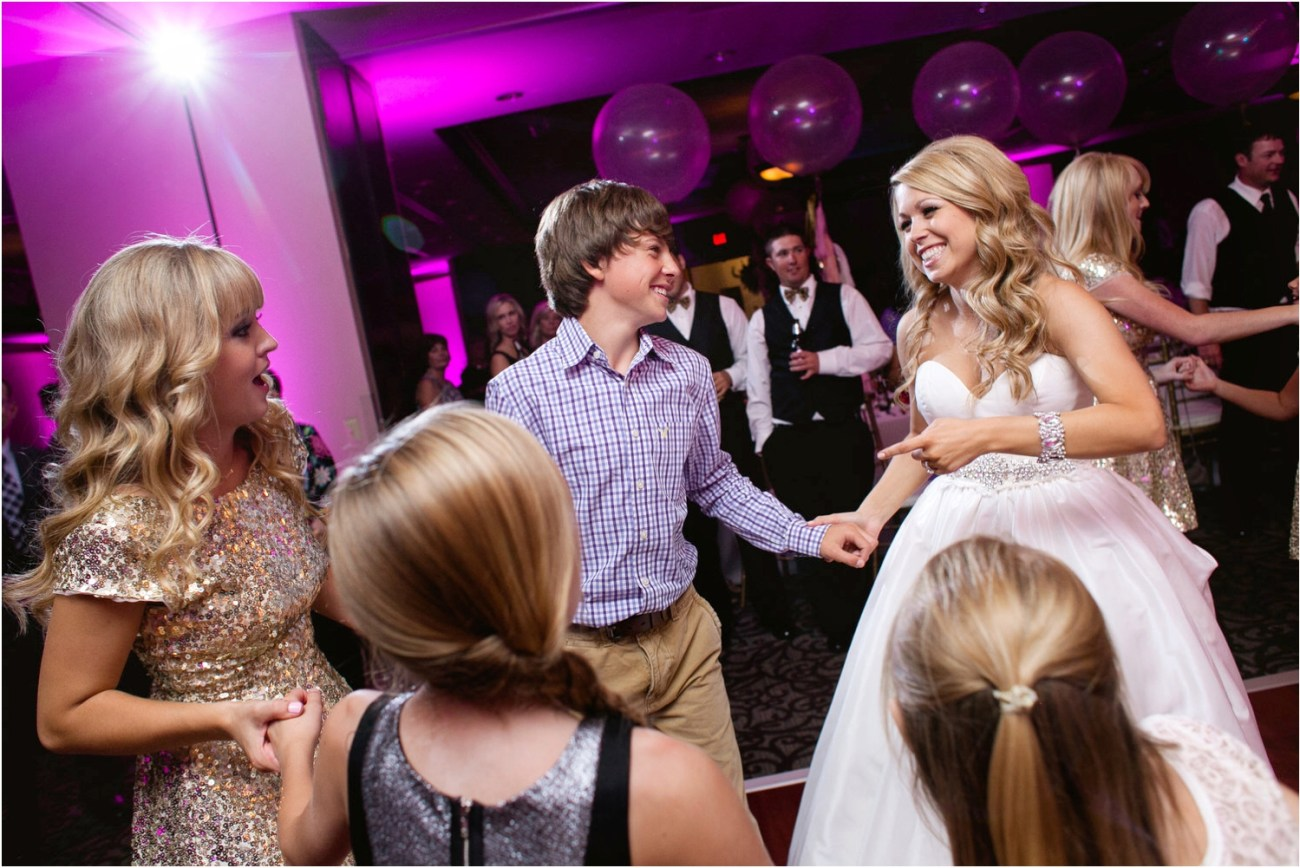 bride dancing with family