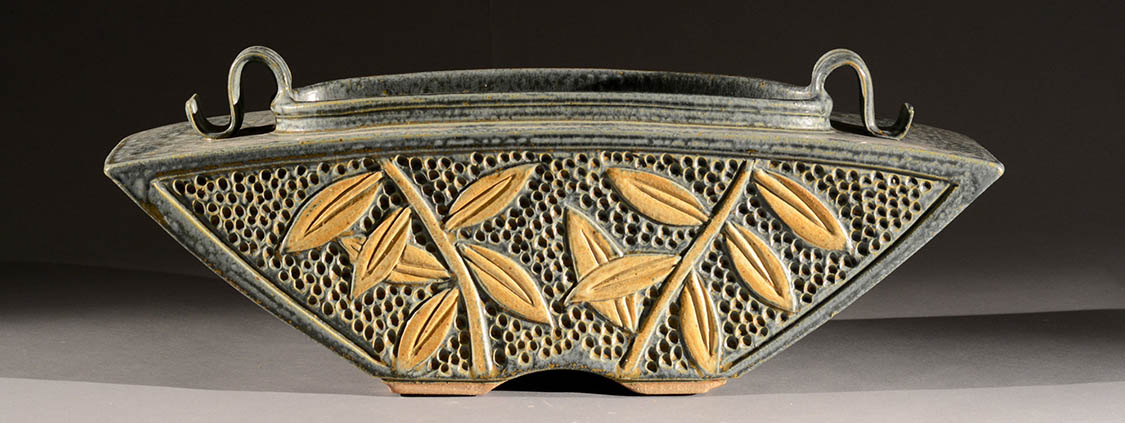 Hand carved ceramic vessel by Jim and Shirl Parmentier