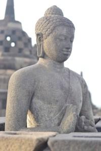 One of multiple Buddhas at Yogyakarta's 9th century temple, Borobudur