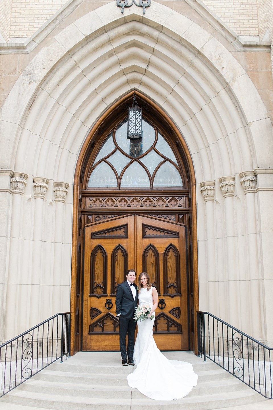 Arielle Peters Photography | Bride and groom outside cathedral doors on wedding day at the Basilica of the Sacred Heart in Notre Dame, Indiana.