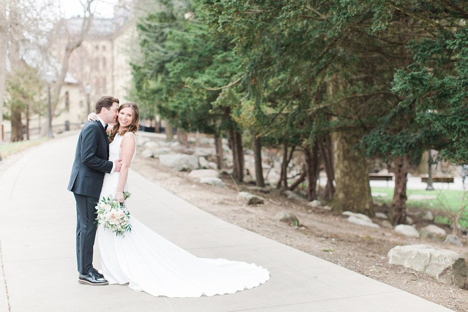 Arielle Peters Photography | Bride and groom walking outside of cathedral on wedding day at the Basilica of the Sacred Heart in Notre Dame, Indiana.