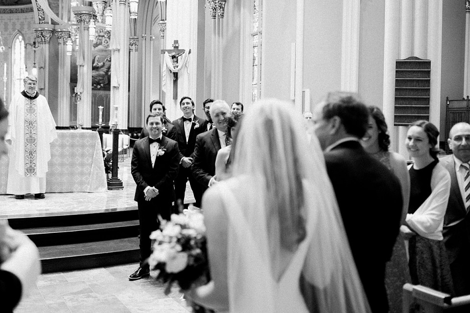 Arielle Peters Photography | Father of bride walking bride down aisle inside cathedral on wedding day at the Basilica of the Sacred Heart in Notre Dame, Indiana.