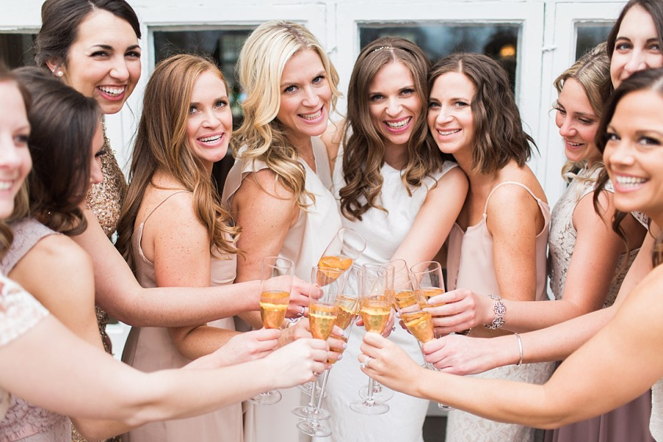 Arielle Peters Photography | Bride and bridesmaids drinking champagne on wedding day at the Basilica of the Sacred Heart in Notre Dame, Indiana.