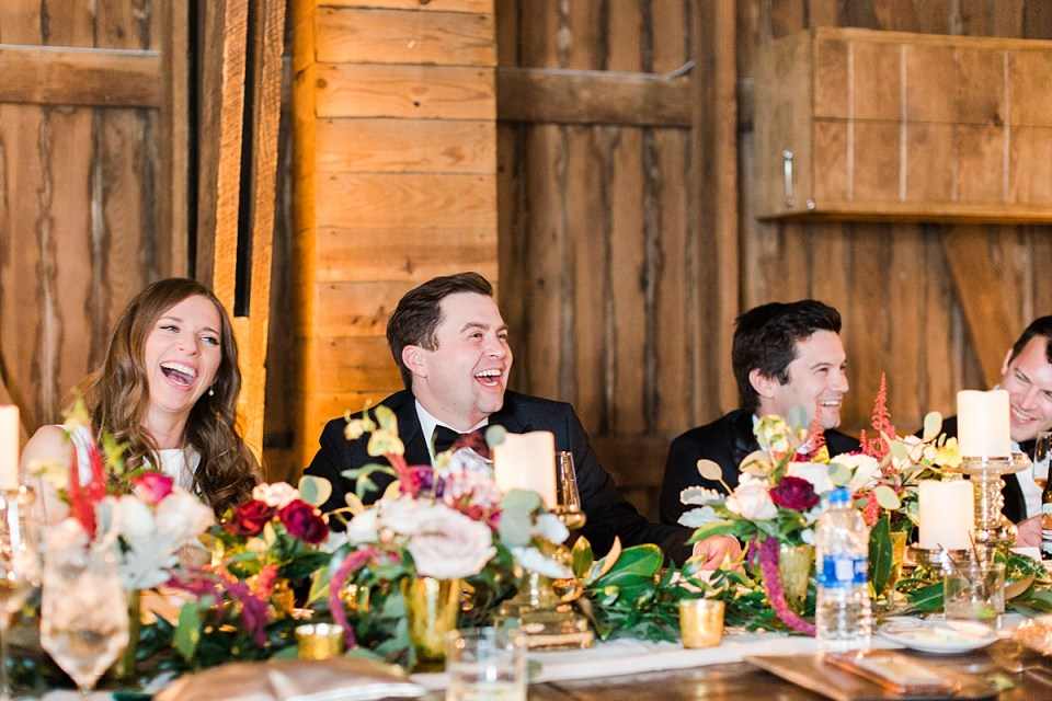 Arielle Peters Photography | Bride and groom laughing at wedding reception on wedding day at St. Joseph's Farm in Granger, Indiana.