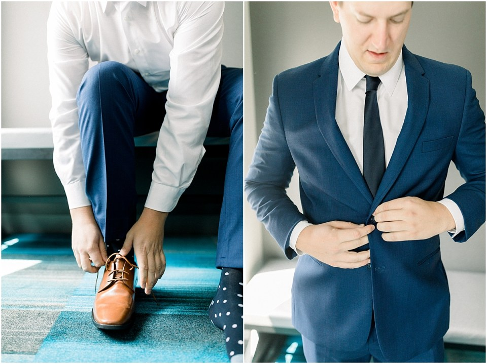 Arielle Peters Photography | Groom putting on jacket getting ready for wedding at The Blue Heron at Blackthorn in South Bend, Indiana on wedding day.