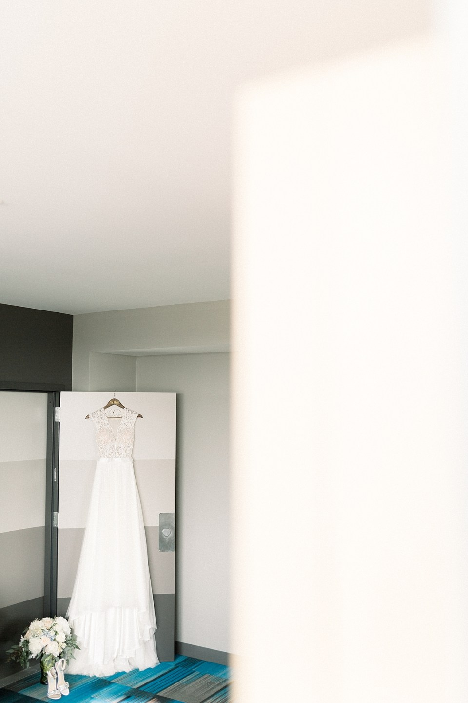 Arielle Peters Photography   Wedding gown hanging at The Blue Heron at Blackthorn in South Bend, Indiana on wedding day.