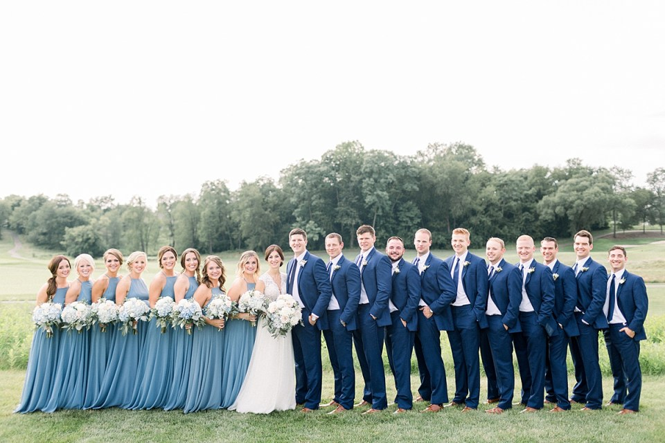 Arielle Peters Photography | Wedding party lined up outside at The Blue Heron at Blackthorn in South Bend, Indiana on wedding day.
