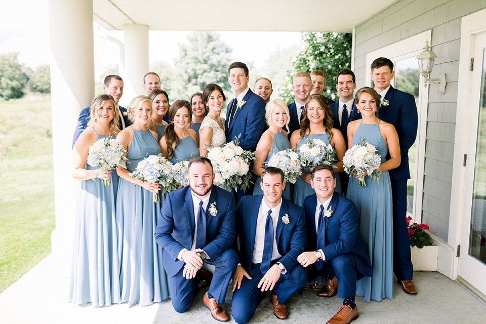 Arielle Peters Photography | Wedding party smiling outside at The Blue Heron at Blackthorn in South Bend, Indiana on wedding day.
