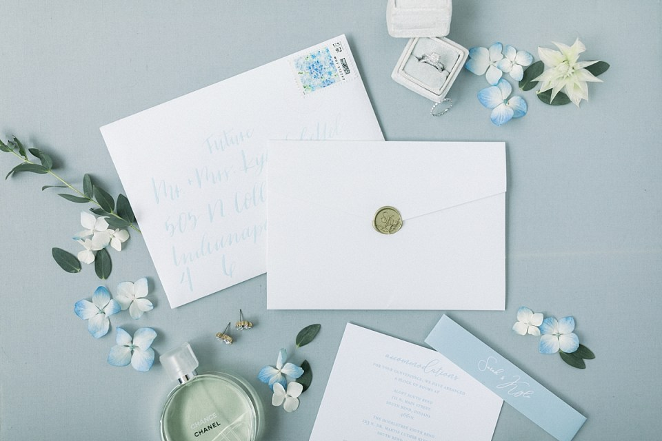 Arielle Peters Photography | Wedding invitation and rings at The Blue Heron at Blackthorn in South Bend, Indiana on wedding day.