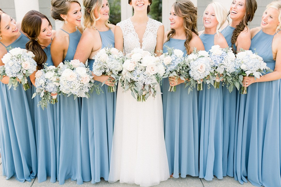 Arielle Peters Photography | Bride and bridesmaids holding bouquets at The Blue Heron at Blackthorn in South Bend, Indiana on wedding day.