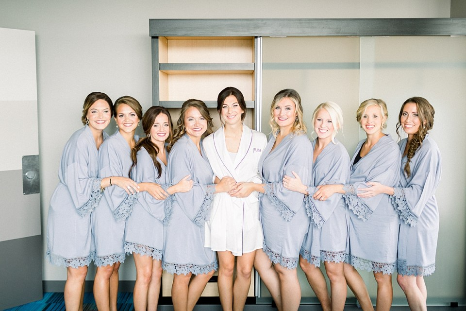 Arielle Peters Photography | Bride and bridesmaids in robes getting ready on wedding day at The Blue Heron at Blackthorn in South Bend, Indiana on wedding day.