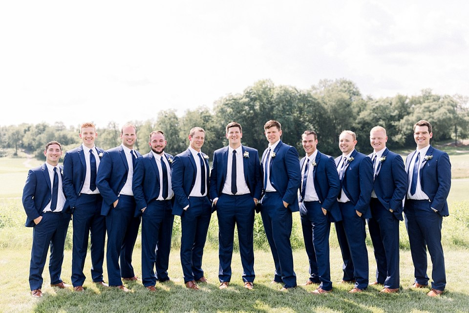 Arielle Peters Photography | Groom and groomsmen with hands in pockets outside at The Blue Heron at Blackthorn in South Bend, Indiana on wedding day.