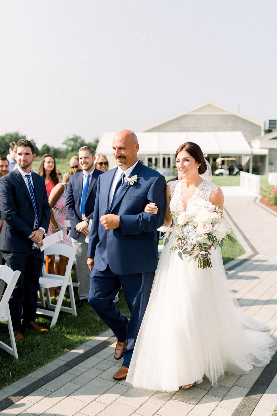 Arielle Peters Photography | Father of the bride walking the bride down the aisle at The Blue Heron at Blackthorn in South Bend, Indiana on wedding day.