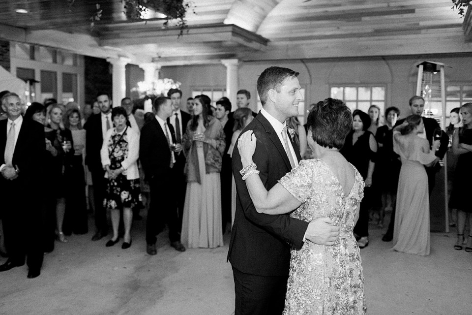 Arielle Peters Photography | Mother of the groom and groom sharing a dance at wedding reception at Sycamore Hills Golf Club in Fort Wayne, Indiana on wedding day.