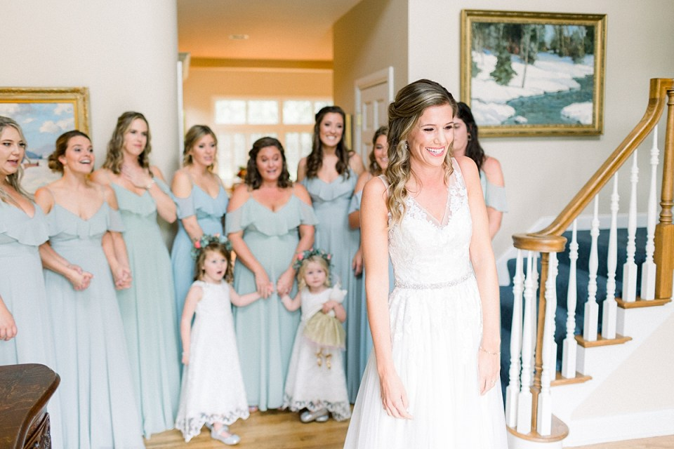 Arielle Peters Photography | Bride revealing wedding gown to bridesmaids at Sycamore Hills Golf Club in Fort Wayne, Indiana on wedding day.