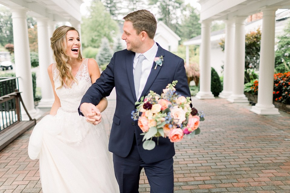 Arielle Peters Photography | Bride and groom holding hands outside on wedding day at Sycamore Hills Golf Club in Fort Wayne, Indiana.