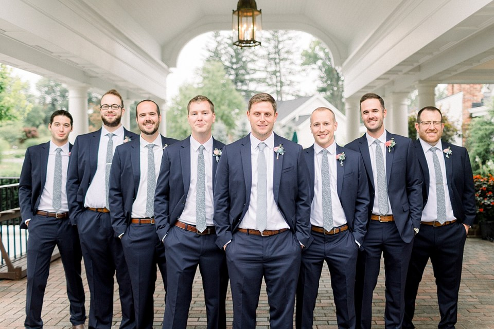 Arielle Peters Photography | Groom and groomsmen smiling outside on wedding day at Sycamore Hills Golf Club in Fort Wayne, Indiana.
