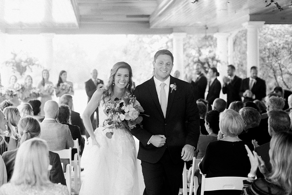 Arielle Peters Photography | Bride and groom walking down the aisle at Sycamore Hills Golf Club in Fort Wayne, Indiana on wedding day.