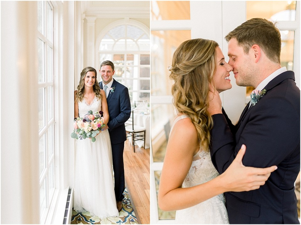 Arielle Peters Photography | Bride and groom kissing by windows at Sycamore Hills Golf Club in Fort Wayne, Indiana on wedding day.