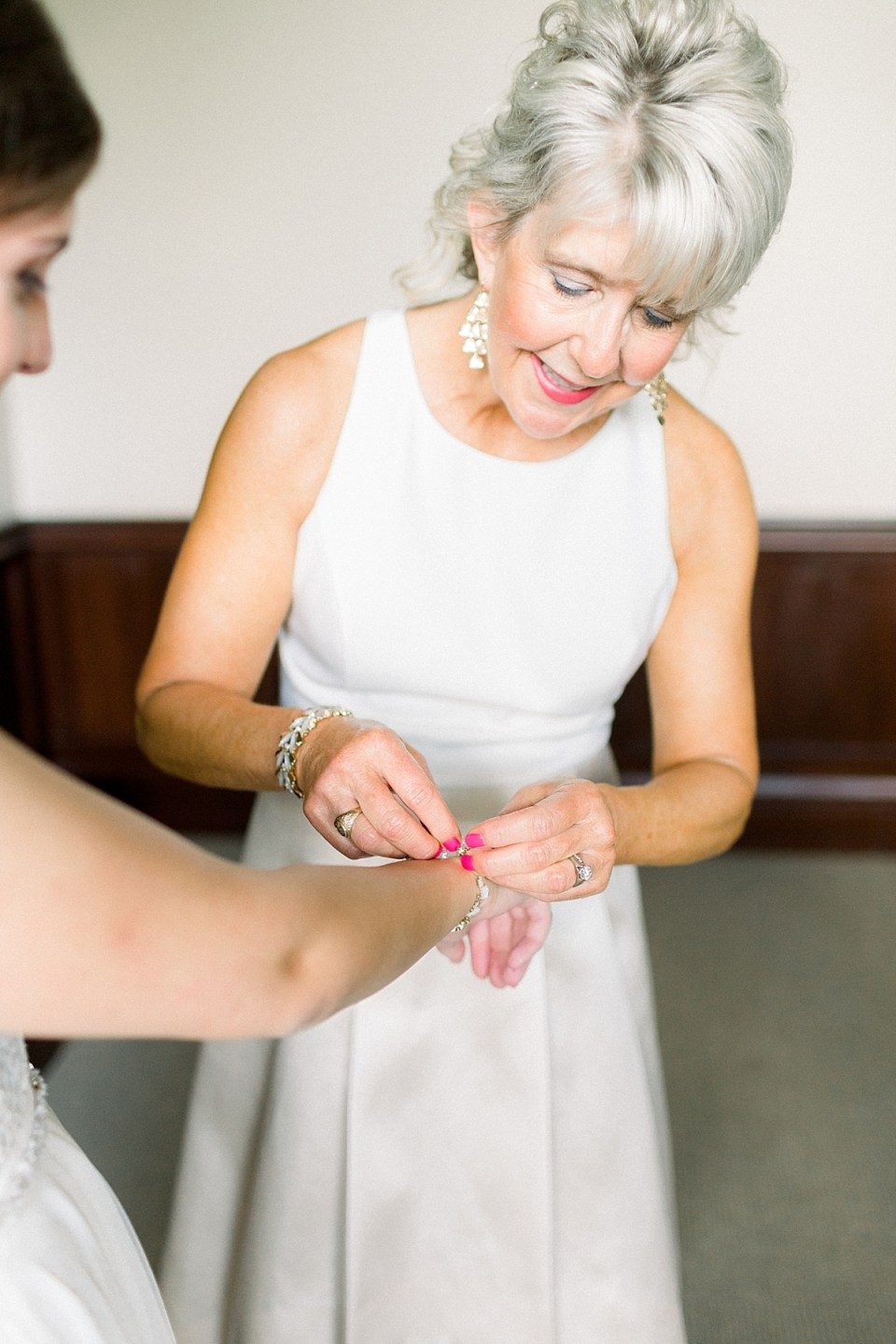 Arielle Peters Photography | Mother of the bride helping the bride get ready at The Bridgewater Club in Carmel, Indiana on wedding day.