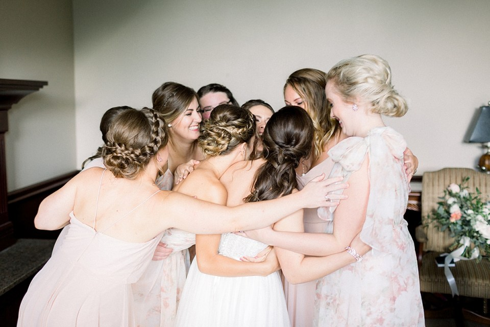 Arielle Peters Photography | Bride and bridesmaids hugging at The Bridgewater Club in Carmel, Indiana on wedding day.