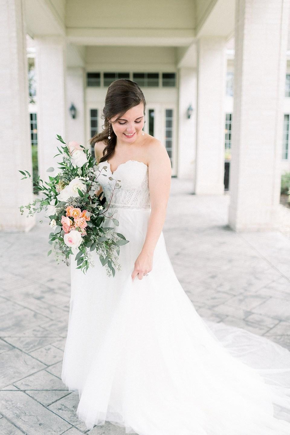 Arielle Peters Photography | Bride dancing in her gown outside at The Bridgewater Club in Carmel, Indiana on wedding day.
