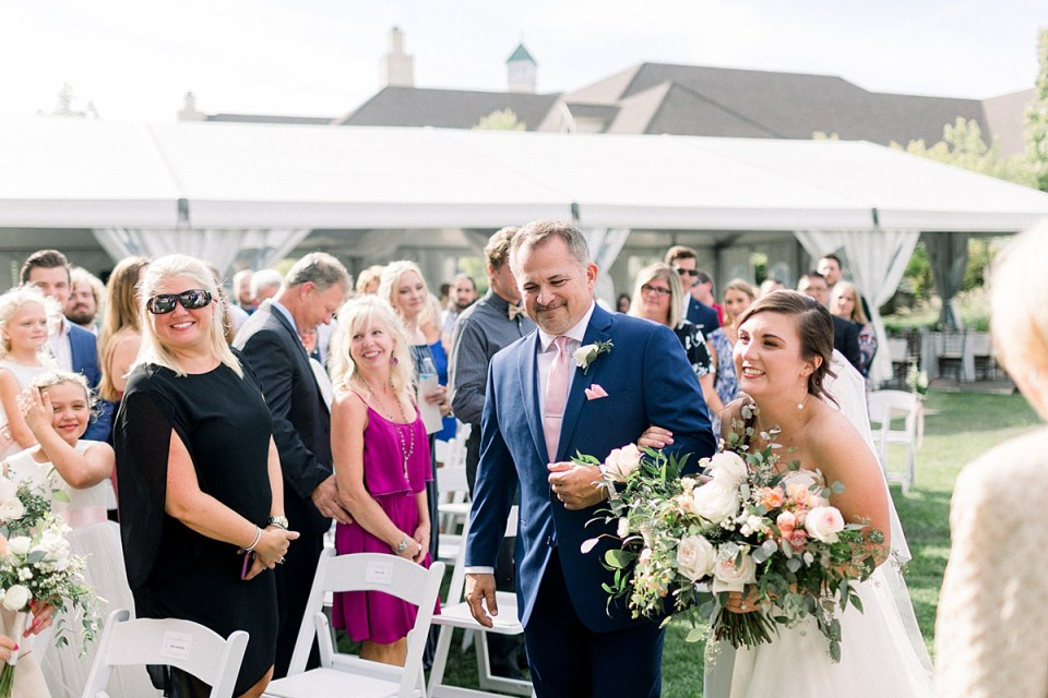 Arielle Peters Photography | Father of the bride walking the bride down the aisle at The Bridgewater Club in Carmel, Indiana on wedding day.