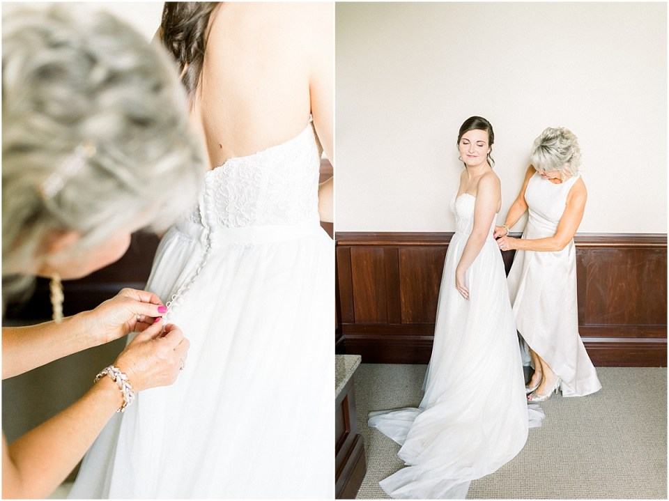 Arielle Peters Photography | Mother of the bride helping the bride put on her dress at The Bridgewater Club in Carmel, Indiana on wedding day.