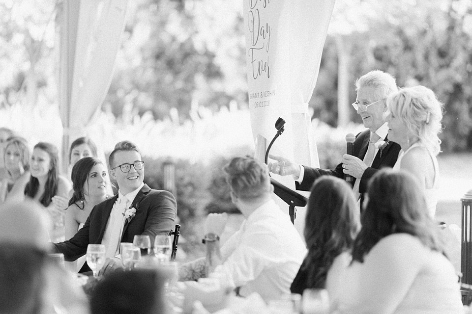 Arielle Peters Photography | Parents giving a speech at the reception at The Bridgewater Club in Carmel, Indiana on wedding day.