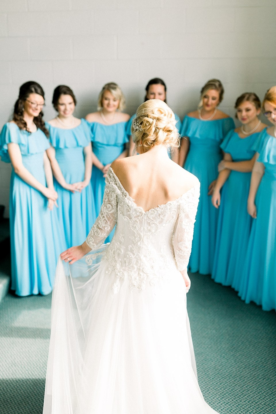 Arielle Peters Photography | Bridesmaids seeing the bride in her dress for the first time on fall wedding day.