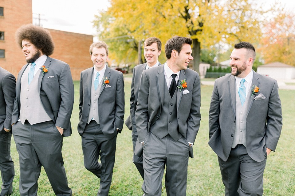 Arielle Peters Photography | Groom and groomsmen walking and laughing outside on fall wedding day.