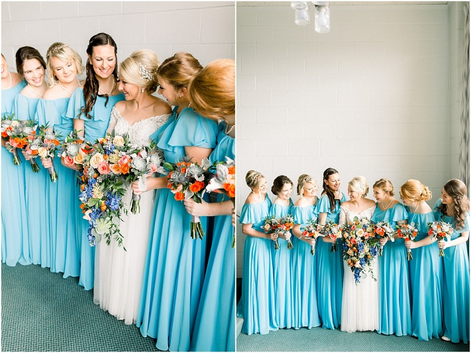 Arielle Peters Photography | Bride and bridesmaids lined up with bouquets smiling on fall wedding day.