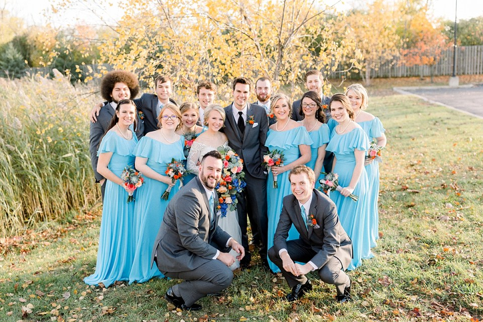 Arielle Peters Photography | Bride and groom smiling with wedding party outside on fall wedding day.