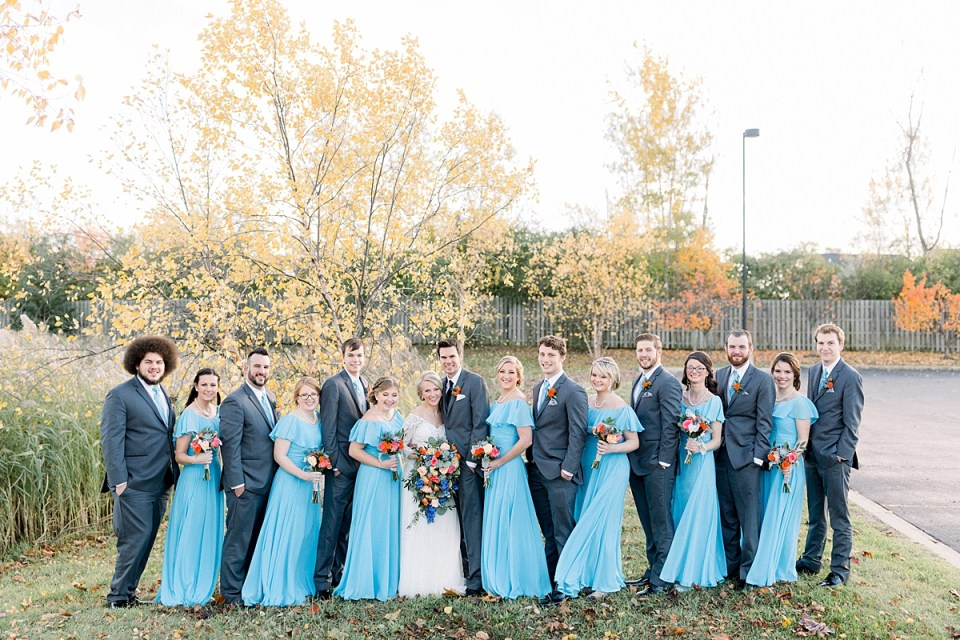 Arielle Peters Photography | Bride and groom lined up with wedding party outside on fall wedding day.