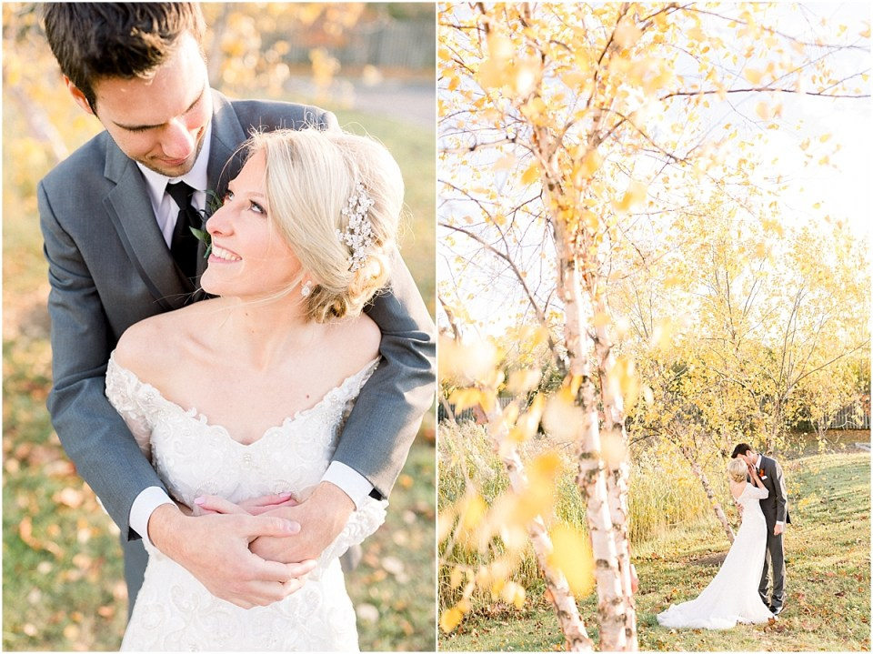 Arielle Peters Photography | Bride and groom kissing outside under trees on a fall wedding day.