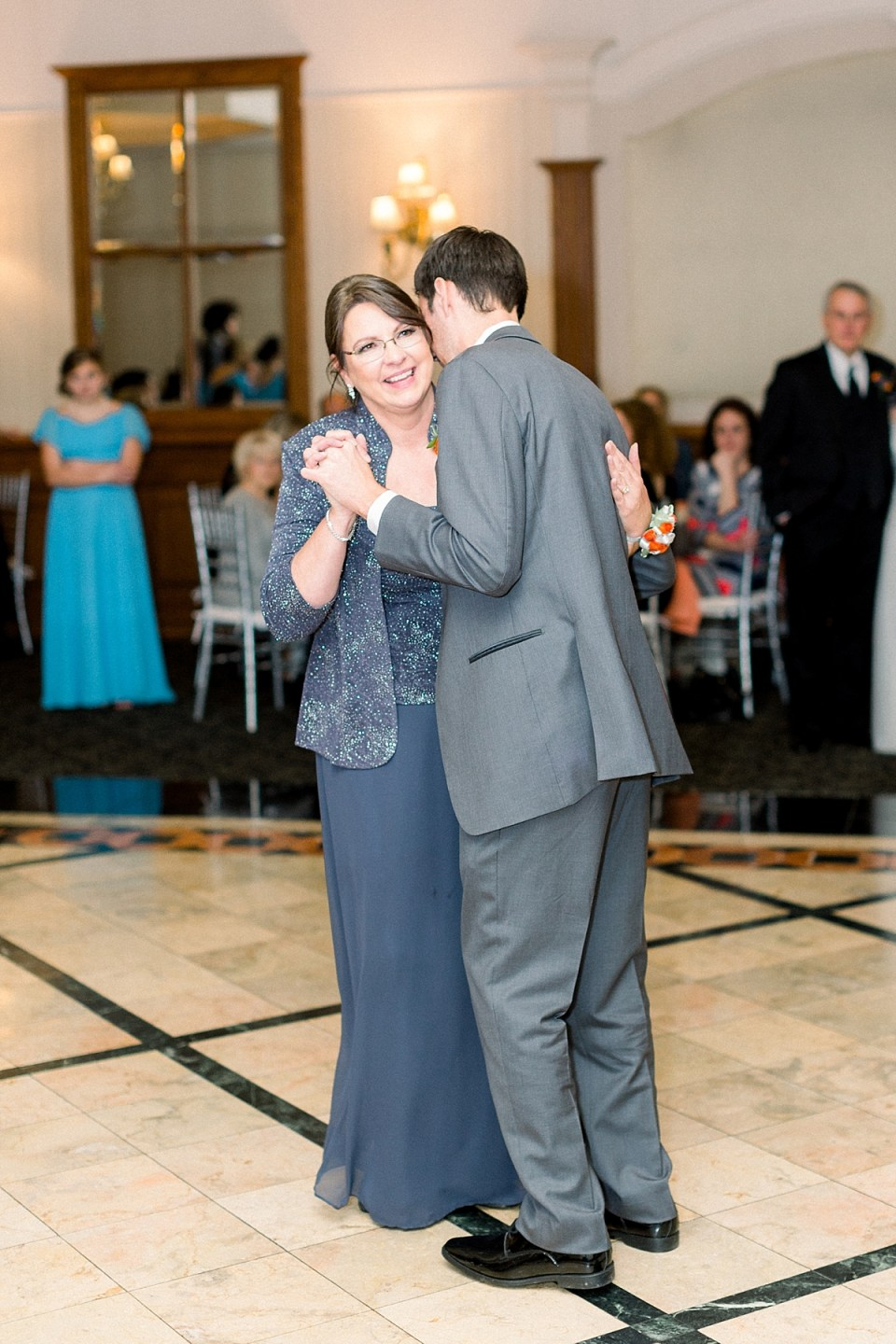 Arielle Peters Photography | Mother of the groom and the groom sharing a dance at fall wedding reception.