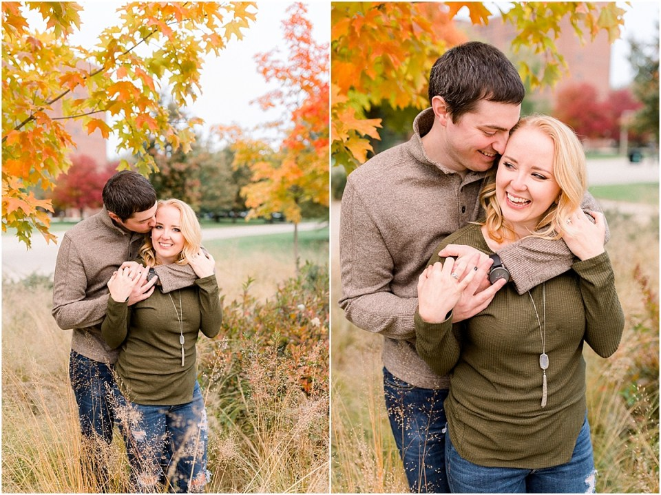 Arielle Peters Photography | Couple laughing and taking fall engagement photos in a field at Purdue University.