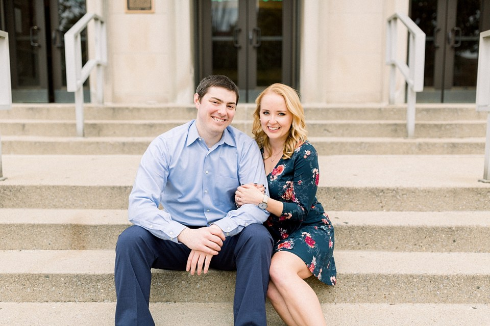 Arielle Peters Photography | Couple sitting on steps and taking fall engagement photos at Purdue University.
