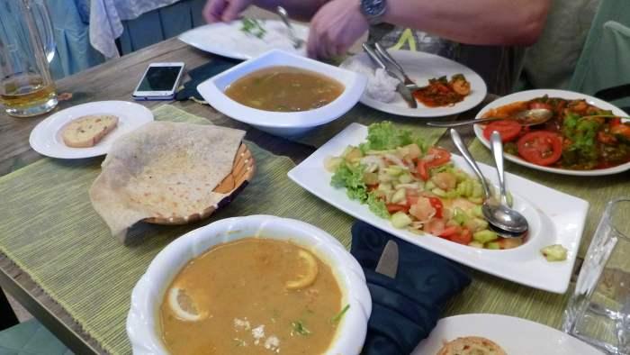 A restaurant table full of Mongolian food in Ulaanbaatar.