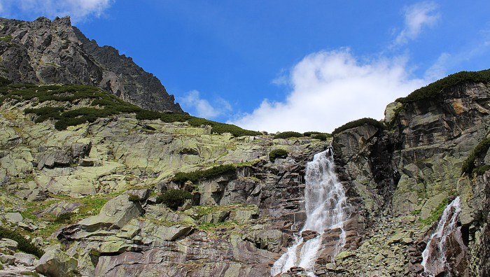 A beautiful waterfall and cliffs in the High Tatras.
