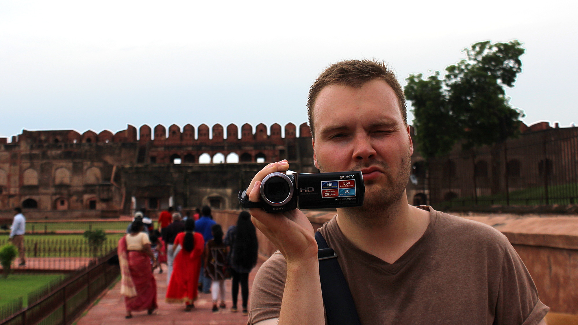 A Western tourist pointing a video camera to the photographer in Agra Fort.