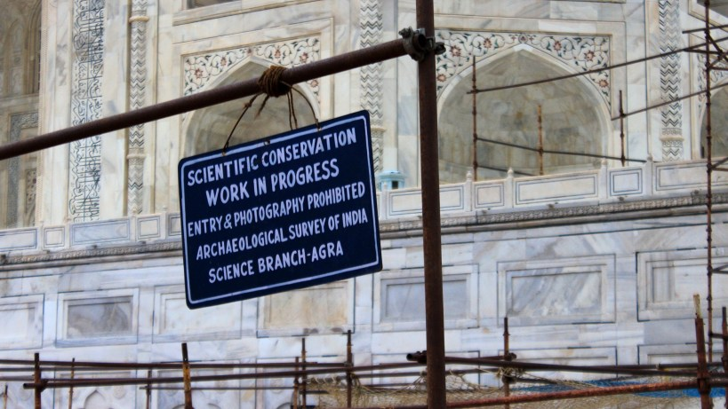 "A sign that says ""Scientific conservation work in progres - entry & photography prohibited. Archeological Survey of India, Science Branch-Agra"" at Taj Mahal under renovation."