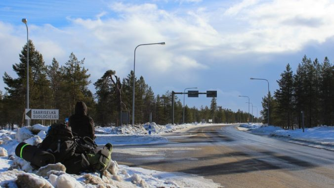 A backpacker hitchiking near Saariselkä in Lapland, Northern Finland.