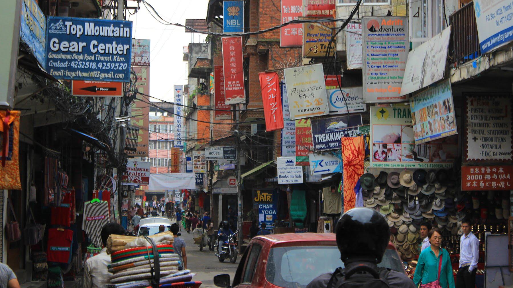 A street with plenty of business signs in Thamel, Kathmandu. I hate Thamel.