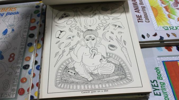 A Ganesh colouring book showing the elepant god Ganesh going on a diet. The god eats vegetables, but dreams od pizza and ice cream. Book on sale in Pilgrim Book House.