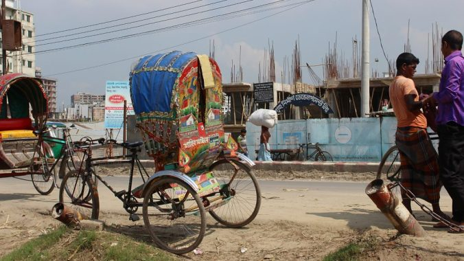 A cycle rickshaw by the side of the road in Bangladesh.