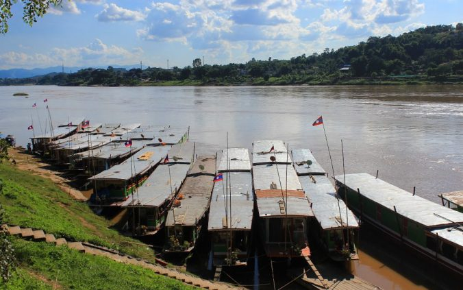 Slow boats waiting at the harbour of Huay Xai, Laos.